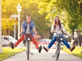 Happy Couple Riding Bikes around Anaheim neighborhoods